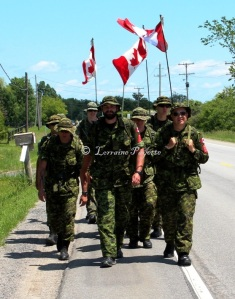 A team of volunteers from RMC prepares for the 97th Nijmegen Four Days Marches to be held in July.  Here they are on their second 40 km march in two days as the walk along Highway No. 2 headed toward Kingston.