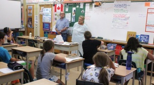 The grade 5/6 class asks the Seymours about the GDHS