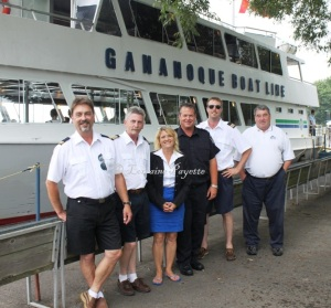 The Gananoque Fire Fighters Association is once again holding their annual cruise on the GBL Islander IV in support of local children's programmes.  Shown here, l-r, engineer Erik Gustafsson, captain Tim Brookes, Kathy MacRae of GBL, professional firefighter Blake Richardson, first mate James Clarke, and GBL general Manager Bill Hayes.