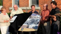 All of Athens came out to celebrate the installation and unveiling of their new Heritage Sign on August 8. L-r, Kathryn Hudson, Athens and Area Historical Society; Athens Mayor Herb Scott; MP Gord Brown and MPP Steve Clark, Leeds-Grenville; and Tom Russell, Thousand Islands Community Development Corporation.