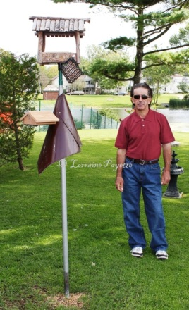 John Higgins with the only two bird feeders in his yard