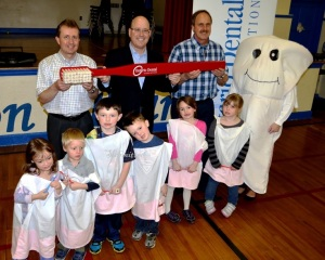 Leeds-Grenville MPP Steve Clark joined Prescott dentists Dr. Lance McIntosh, left, and Dr. Kim Hansen along with Timmy the Tooth to deliver an important message about oral health to students at Benson Public School in Cardinal on Friday, April 11. They're with a group of students who volunteered to be teeth in order to demonstrate proper brushing techniques to their classmates.